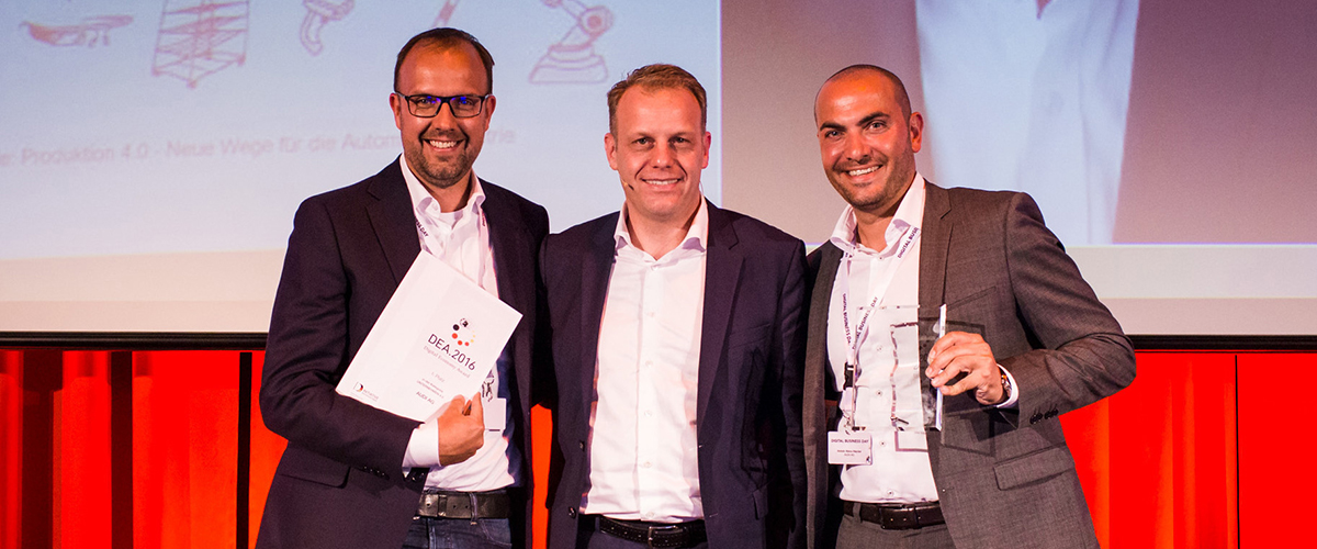 """Audi has won the """"Digital Economy Award"""" in the Company 4.0 category. With this prize, Initiative Deutschland Digital recognizes companies and organizations that increase their efficiency and value creation by applying digital technologies and new business models.  In the picture: André Ziemke (left), Chief Executive of nextLAP GmbH, and Antoin Abou-Haydar (right), Head of Vehicle Assembly Audi A4/A5/Q5, AUDI AG, with jury member Michael Nilles, Member of the Group Executive Committee and Chief Digital Officer of Schindler Aufzüge AG."""